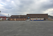 A wide angle view of the rear parking lot at the former KHS Keyser High School located in Keyser, WV.